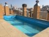 Vista piscina edificio